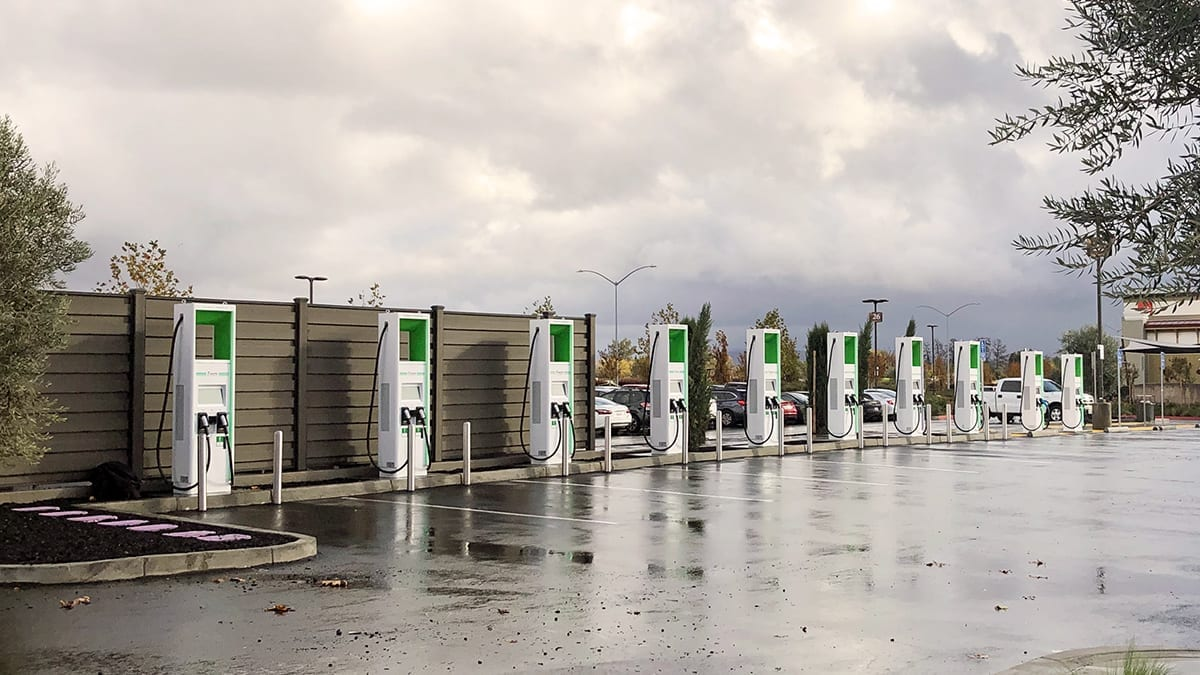 Image of a row of ABB electric vehicle chargers.